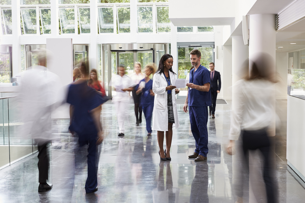 doctor in a busy hospital lobby